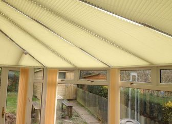 Pleated roof blinds fitted in a conservatory in Budleigh Salterton.