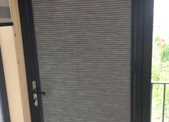 Perfect fit blackout pleated blinds fitted on a bifold door in Exmouth.