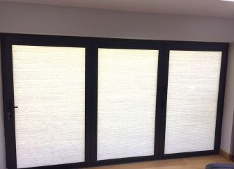Pleated blinds fitted on bifold doors at a house in Exeter.